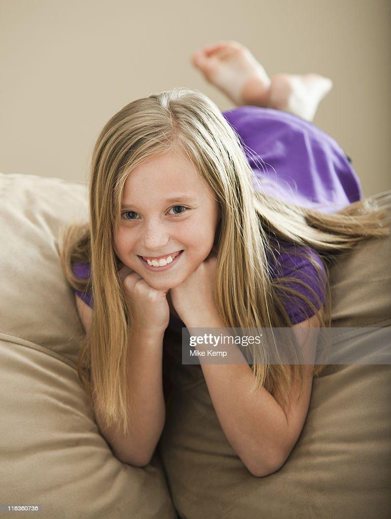 USA, Utah, Lehi, Portrait of girl (8-9) lying on sofa