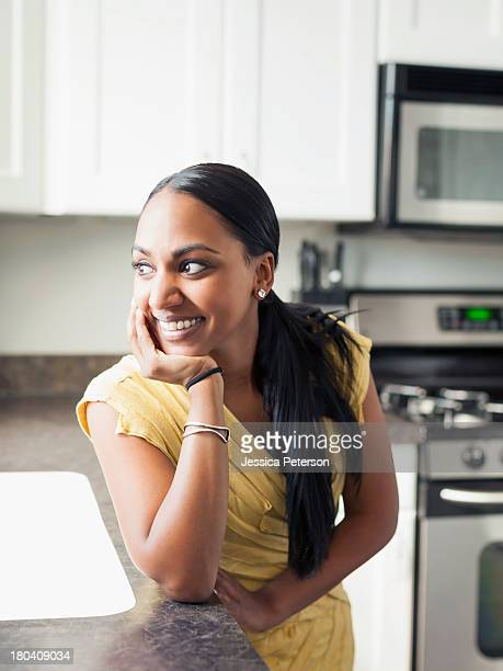 USA, Utah, Lehi, Portrait of woman standing in kitchen
