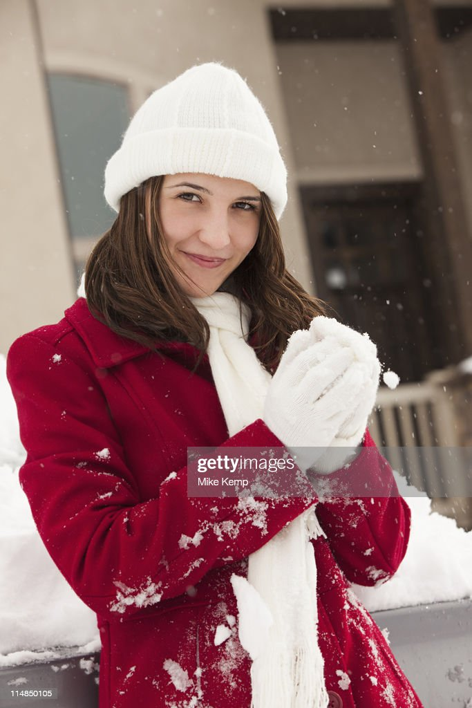 USA, Utah, Lehi, Portrait of young woman holding snowball : Stock Photo