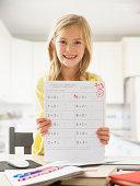 USA, Utah, Lehi, Proud girl (6-7) showing math test