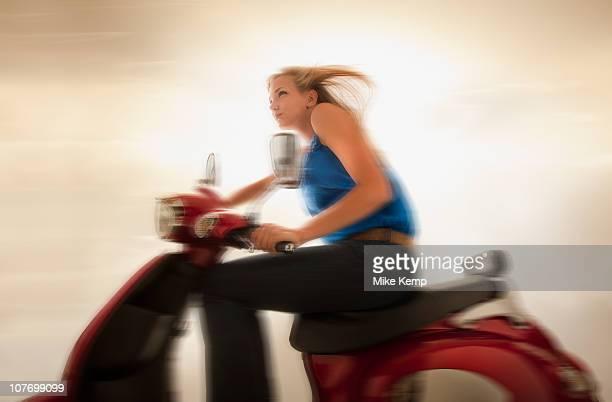 USA, Utah, Lehi, Young girl (16-17) riding scooter