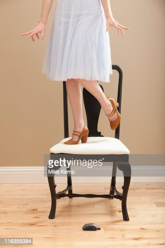Usa Utah Lehi Young Woman Standing On Chair Evading Mouse