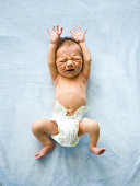 USA, Utah, Orem, Baby (0-1 months) lying on back