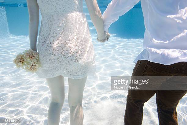 USA, Utah, Orem, Wedding couple under water