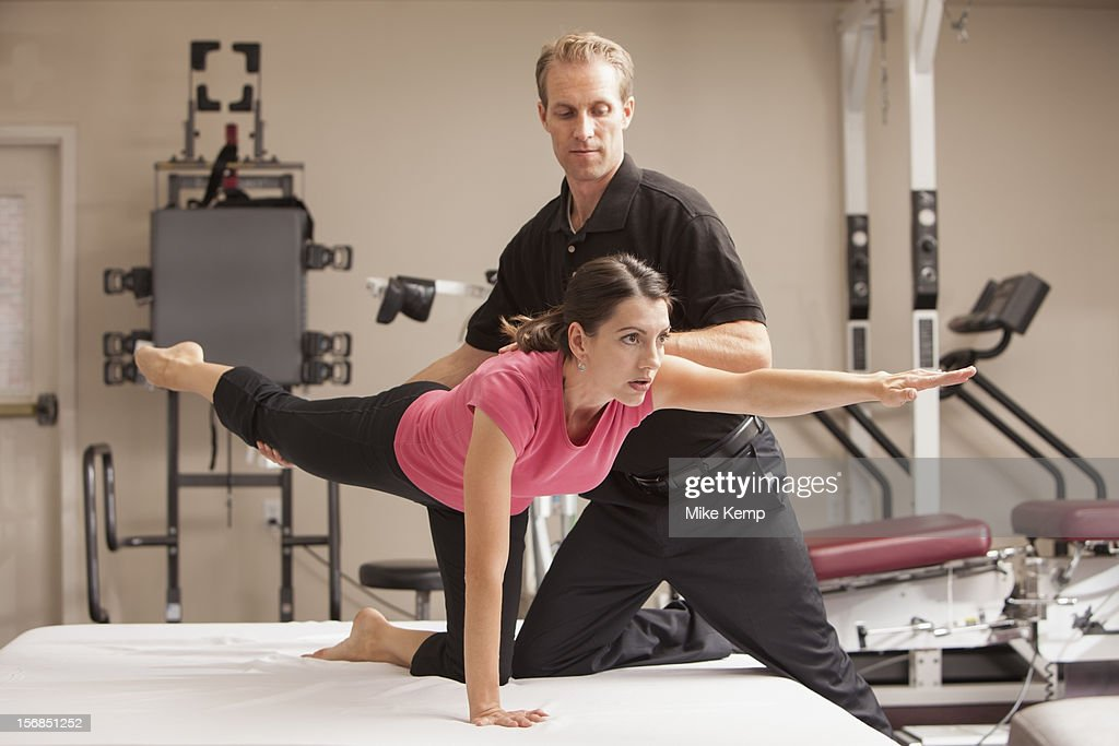 USA, Utah, Orem, Woman at physical therapy facility being treated