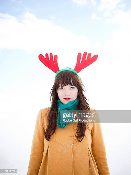 USA, Utah, Orem, young woman wearing reindeer horns, portrait