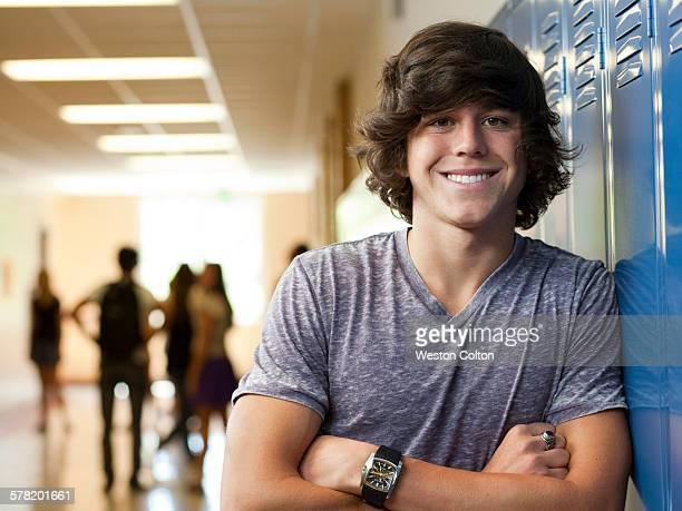 USA, Utah, Portrait of young man in school corridor