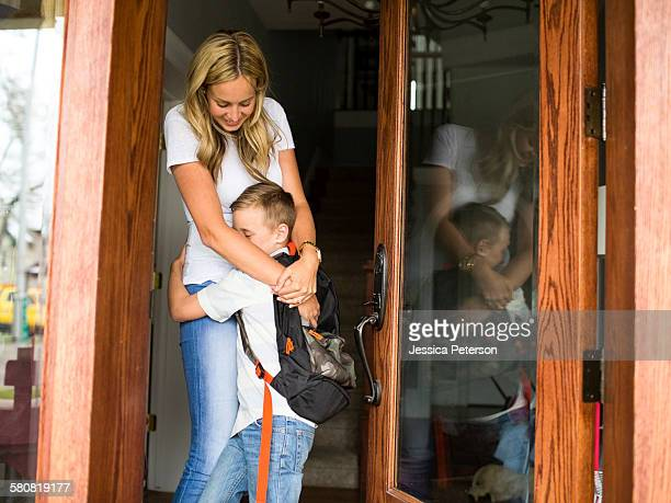 USA, Utah, Provo, Boy (6-7) hugging mother before leaving for school