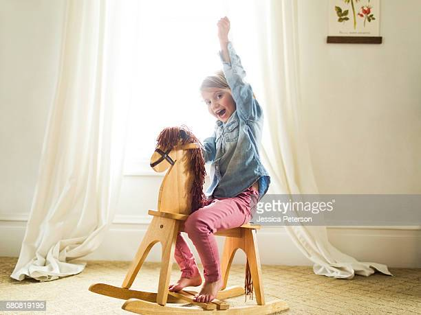 USA, Utah, Provo, Girl (4-5)on rocking horse