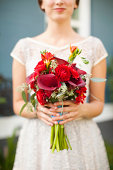 USA, Utah, Provo, Mid section of bride with bouquet in focus