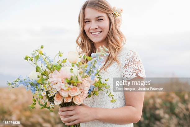 USA, Utah, Provo, Portrait of bride holding bunch of flowers