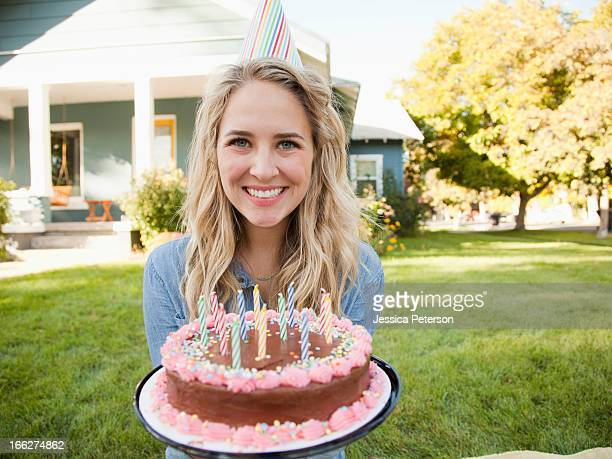 USA, Utah, Provo, Portrait of young woman holding birthday cake