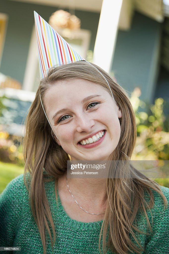 USA, Utah, Provo, Portrait of young woman in party hat : Stock Photo