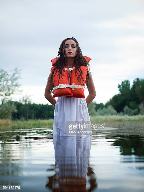 USA, Utah, Provo, woman wearing life jacket standing in lake
