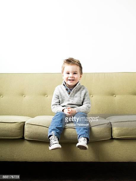 USA, Utah, Salt Lake City, Baby boy (2-3) sitting on sofa