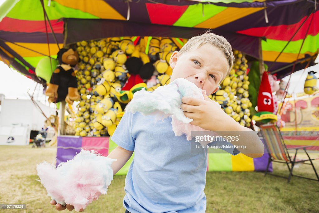 USA, Utah, Salt Lake City, Boy (4-5) eating cotton candy in amusement park