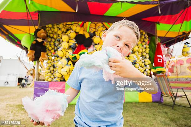 USA, Utah, Salt Lake City, Boy (4-5) eating cotton candy in amusement park