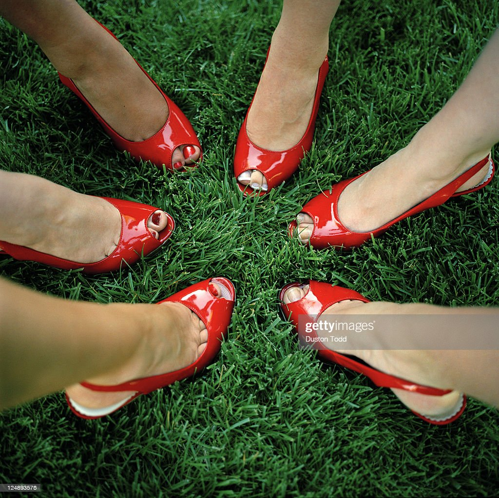 USA, Utah, Salt Lake City, Close-up on six women feet in red peep toe shoes
