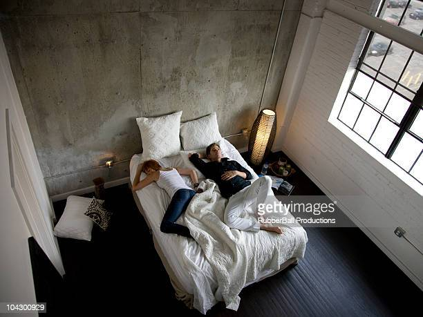 USA, Utah, Salt Lake City, Couple sleeping on bed, elevated view