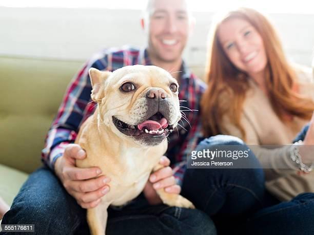 USA, Utah, Salt Lake City, Couple with pug sitting on sofa