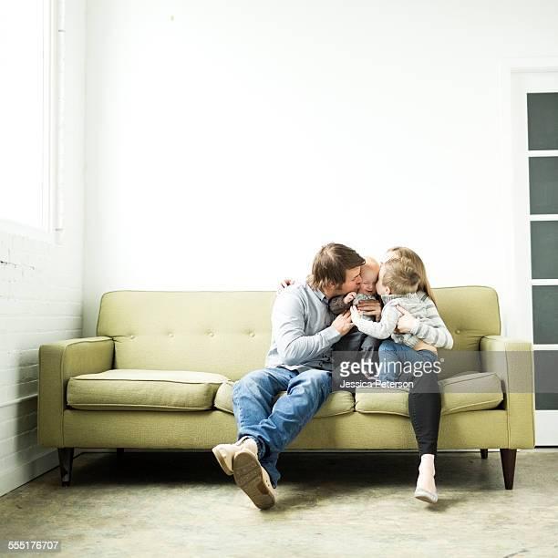 USA, Utah, Salt Lake City, Family embracing on sofa