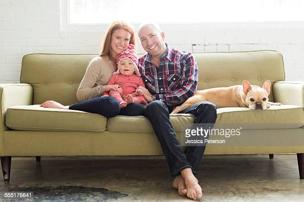 USA, Utah, Salt Lake City, Family with baby son (2-3) and pug on sofa