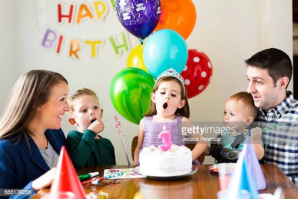 USA, Utah, Salt Lake City, Family with three children (2-3, 4-5) celebrating birthday