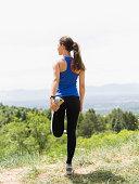 USA, Utah, Salt Lake City, Female jogger stretching
