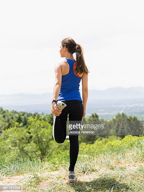 USA, Utah, Salt Lake City, Female jogger stretching