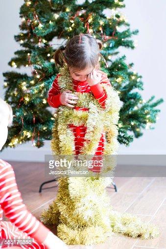 USA, Utah, Salt Lake City, Girl (4-5) decorating christmas tree