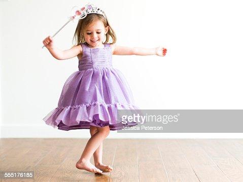 USA, Utah, Salt Lake City, Girl (4-5) in princess costume dancing