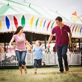 USA, Utah, Salt Lake City, Happy Family and son (4-5) in amusement park