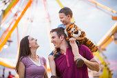 USA, Utah, Salt Lake City, Happy Family with son (4-5 ) in amusement park
