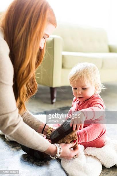 USA, Utah, Salt Lake City, Mother dressing son (2-3) in living room