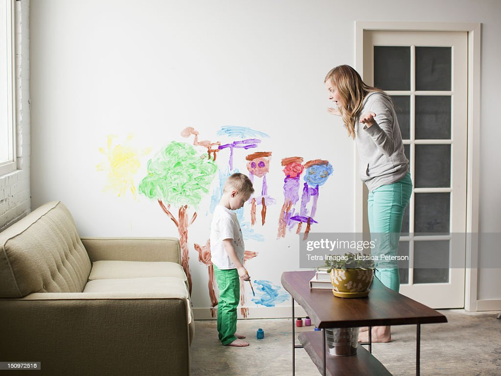 USA, Utah, Salt Lake City, Mother telling toddler boy (2-3) off for painting on walls : Stock Photo