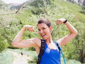 USA, Utah, Salt Lake City, Portrait of athletic woman flexing muscles