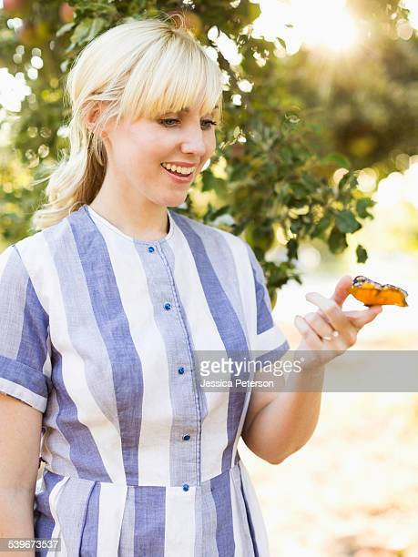 USA, Utah, Salt Lake City, Portrait of blond woman with butterfly in orchard