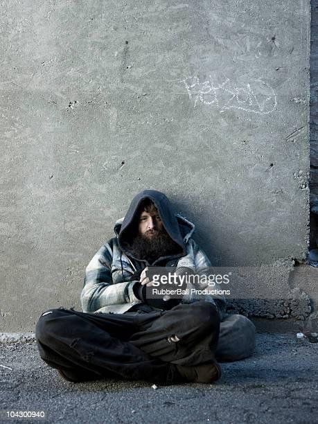 USA, Utah, Salt Lake City, Portrait of homeless man sitting on sidewalk