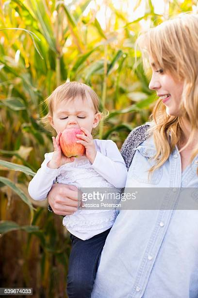 USA, Utah, Salt Lake City, Portrait of mother and daughter (12-17 months) in field