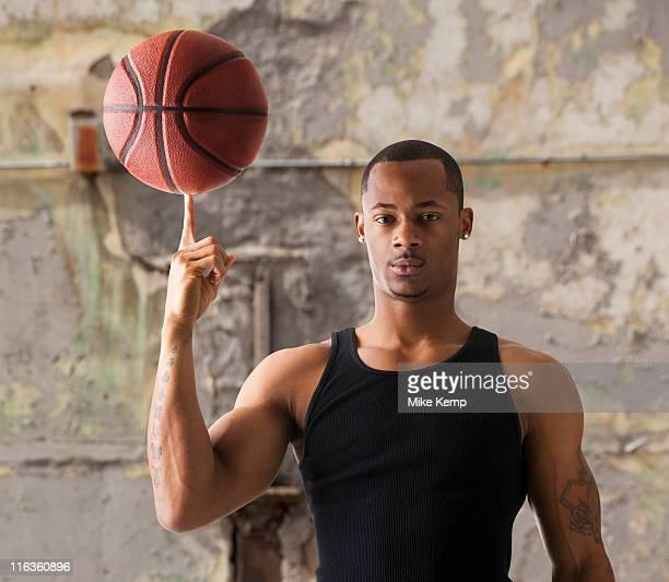 USA, Utah, Salt Lake City, Portrait of young man with basketball