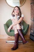 USA, Utah, Salt Lake City, Portrait of young woman sitting on armchair
