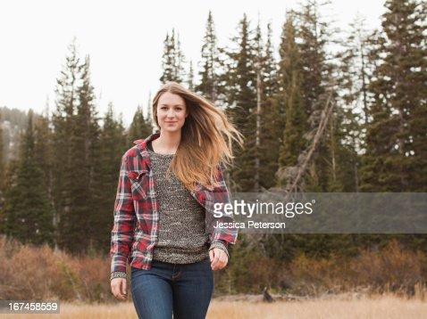 USA, Utah, Salt Lake City, portrait of young woman walking in non-urban scene : Stock Photo