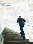 USA, Utah, Salt Lake City, Rear view of man running up stairs