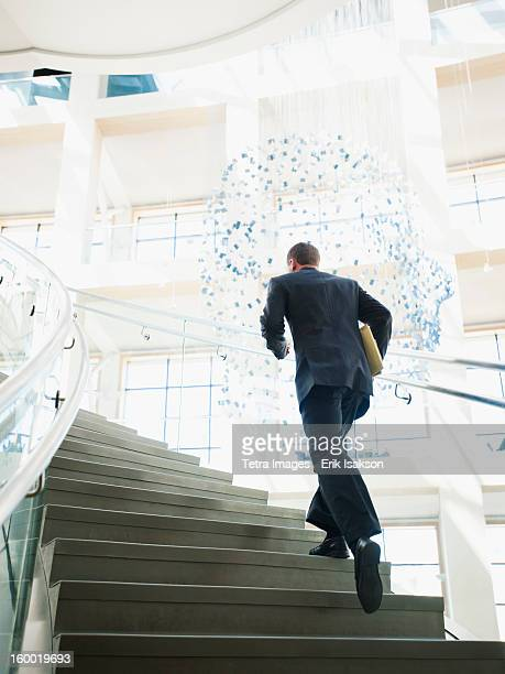 USA, Utah, Salt Lake City, Rear view of man running up stairs