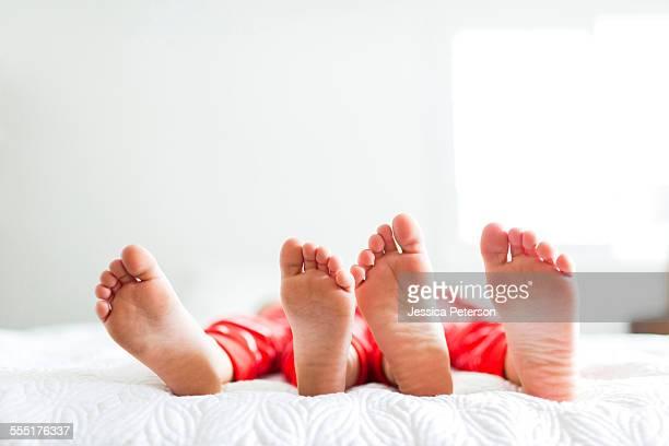 USA, Utah, Salt Lake City, Siblings (2-3, 4-5) in red pajamas