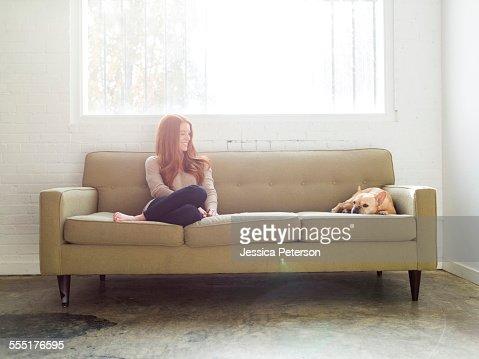 USA, Utah, Salt Lake City, Woman and pug on sofa