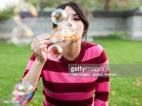 USA, Utah, Salt Lake City, Woman blowing bubbles