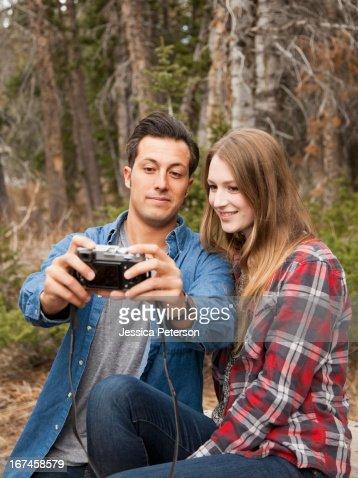 USA, Utah, Salt Lake City, young couple self photographing in non-urban scene : Stock Photo