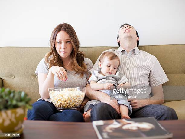 USA, Utah, Salt Lake City, Young couple with baby boy (6-11 months) watching TV