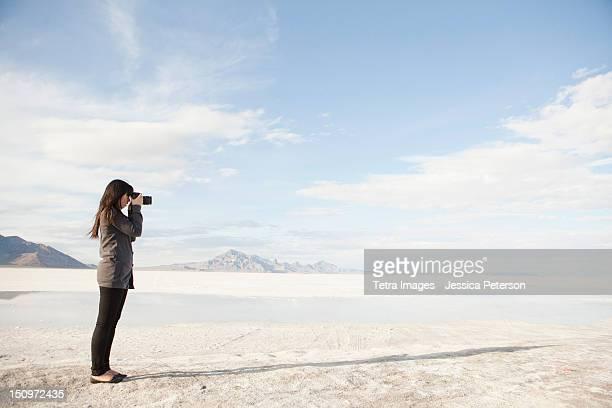 USA, Utah, Salt Lake City, Young woman taking photos